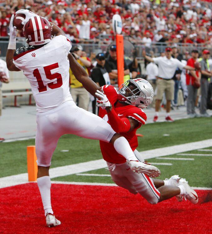 Indiana receiver Nick Westbrook, left, catches a touchdown pass against Ohio State defensive back Jeffrey Okudah during the first half of an NCAA college football game Saturday, Oct. 6, 2018, in Columbus, Ohio. (AP Photo/Jay LaPrete)