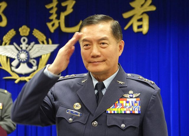 FILE - In this March 7, 2019, file photo, Taiwanese top military official Shen Yi-ming salutes as he is introduced to journalists during a press conference in Taipei, Taiwan. The defense ministry confirmed that Shen and a number of others were killed in a helicopter crash in a mountainous area in New Taipei City early Thursday morning. (AP Photo/Johnson Lai, File)