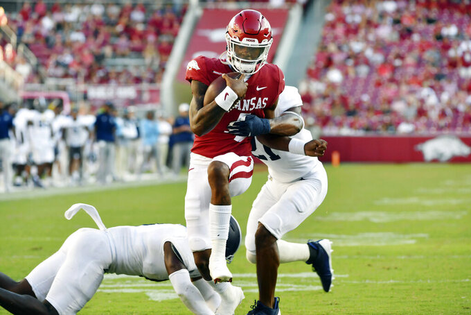 Arkansas quarterback Malik Hornsby (4) runs for a touchdown against Georgia Southern during the second half of an NCAA college football game Saturday, Sept. 18, 2021, in Fayetteville, Ark. (AP Photo/Michael Woods)