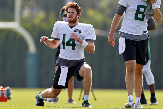 New York Jets quarterback Sam Darnold (14) stretches during a practice at the NFL football team's training camp in Florham Park, N.J., Tuesday, Aug. 25, 2020. (AP Photo/Adam Hunger)