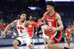 Georgia forward Toumani Camara (10) drives against Mississippi guard Breein Tyree (4) in the first half of an NCAA college basketball game in the Southeastern Conference Tournament Wednesday, March 11, 2020, in Nashville, Tenn. (AP Photo/Mark Humphrey)