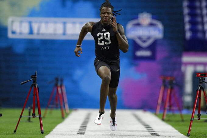 FILE - In this Feb. 27, 2020, file photo, Alabama wide receiver Jerry Jeudy runs the 40-yard dash at the NFL football scouting combine in Indianapolis. With their blazing speed on offense, the Kansas City Chiefs ran away from their AFC West brethren en route to their first Super Bowl title in half a century.  The Broncos used their first two draft picks on speedy wide receivers Jerry Jeudy of Alabama and KJ Hamler of Penn State to keep up with the likes of Tyreek Hill and Sammy Watkins. (AP Photo/Michael Conroy, File)