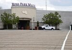 An empty parking lot at Ross Park Mall is seen on the day of yellow phase reopening Friday, May 15, 2020, in Ross, Pa. (Christopher Horner/Pittsburgh Tribune-Review via AP)