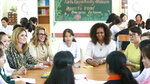 Former U.S. fist lady Michelle Obama, actress Julia Roberts, fifth left, and Jenna Bush Hager, fourth left, talk with female students at the Can Giuoc high school in Long An province, Vietnam on Monday, Dec. 9, 2019. Mrs. Obama is on a trip to Vietnam to promote education for adolescent girls. (AP Photo/Hau Dinh)
