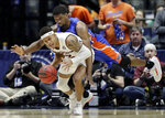 Auburn guard Bryce Brown (2) is fouled by Florida center Kevarrius Hayes in the second half of an NCAA college basketball game at the Southeastern Conference tournament Saturday, March 16, 2019, in Nashville, Tenn. Auburn won 65-62. (AP Photo/Mark Humphrey)