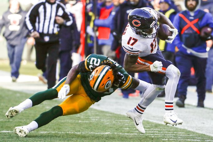 Chicago Bears' Anthony Miller is tackled by Green Bay Packers' Kevin King after a catch during the first half of an NFL football game Sunday, Dec. 15, 2019, in Green Bay, Wis. (AP Photo/Matt Ludtke)