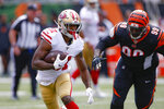 San Francisco 49ers running back Raheem Mostert (31) runs the ball past Cincinnati Bengals defensive tackle Andrew Billings (99) during the second half an NFL football game, Sunday, Sept. 15, 2019, in Cincinnati. (AP Photo/Gary Landers)