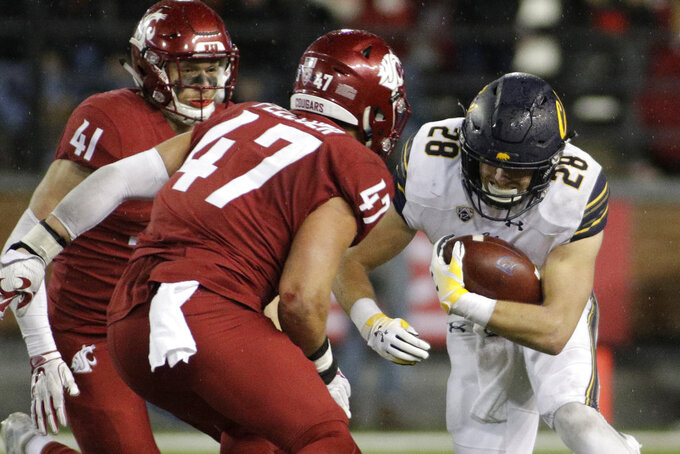 California running back Patrick Laird (28) runs while defended by Washington State linebacker Peyton Pelluer (47) during the second half of an NCAA college football game in Pullman, Wash., Saturday, Nov. 3, 2018. Washington State won 19-13. (AP Photo/Young Kwak)