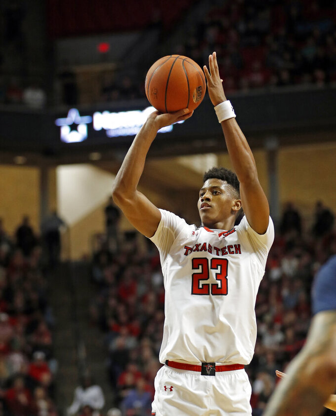 Texas Tech's Jarrett Culver (23) shoots the ball during the first half of an NCAA college basketball game against West Virginia, Monday, Feb. 4, 2019, in Lubbock, Texas. (AP Photo/Brad Tollefson)