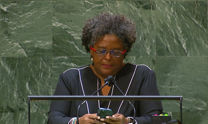 Mia Amor Mottley, Prime Minister of Barbados, addresses the 76th Session of the U.N. General Assembly at United Nations headquarters on Friday, Sept. 24, 2021. The General Assembly hall is equipped with a teleprompter, but few leaders used it Friday, with most opting for paper speeches. While reading speech texts from phones has become more common in general, the practice remains rare at the General Assembly. (UN WebTV via AP)
