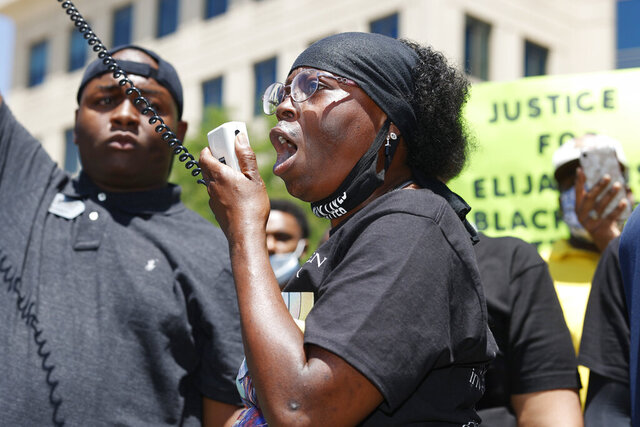 FILE - In this June 27, 2020, file photo, Sheneen McClain speaks during a rally and march over the death of her son, Elijah McClain, outside the police department in Aurora, Colo. The parents of Elijah McClain, a 23-year-old Black man who died after officers in suburban Denver stopped him on the street last year and put him in a chokehold, sued police and medical officials Tuesday, Aug. 11. (AP Photo/David Zalubowski, File)