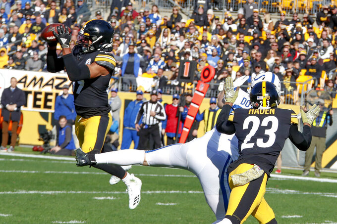 Pittsburgh Steelers free safety Minkah Fitzpatrick (39) makes an interception of a pass intended for Indianapolis Colts tight end Jack Doyle (84) in the first half of an NFL football game, Sunday, Nov. 3, 2019, in Pittsburgh. Fitzpatrick ran it back for a touchdown. (AP Photo/Gene J. Puskar)