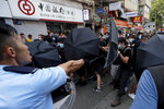 Police and protesters scuffle in Hong Kong on Saturday, July 13, 2019. Several thousand people marched in Hong Kong on Saturday against traders from mainland China in what is fast becoming a summer of unrest in the semi-autonomous Chinese territory. (AP Photo/Kin Cheung)