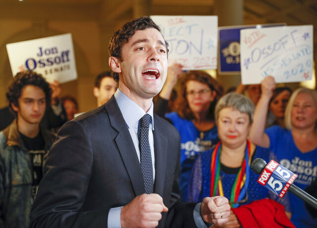 FILE - In this Wednesday, March 4, 2020 file photo, Jon Ossoff speaks to the media and supporters after he qualified to run in the Senate race against Republican Sen. David Perdue in Atlanta. The Democratic Senate candidate is in isolation as is his wife, who contracted COVID-19, Ossoff confirmed Saturday, July 25, 2020. (Bob Andres/Atlanta Journal-Constitution via AP)