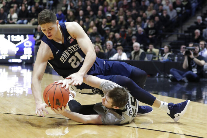 Penn State forward John Harrar (21) and Purdue guard Sasha Stefanovic (55) go for the ball during the first half of an NCAA college basketball game in West Lafayette, Ind., Saturday, Feb. 16, 2019. (AP Photo/Michael Conroy)