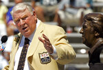 "FILE - In this Aug. 5, 2006, file photo, former Oakland Raiders coach John Madden gestures toward a bust of himself during his enshrinement into the Pro Football Hall of Fame in Canton, Ohio. After a decade run as a successful coach of the Raiders, Madden made his biggest impact on the game after moving to the broadcast booth at CBS in 1979. He became the network's lead analyst two years later and provided the sound track for NFL games for most of the next three decades, entertaining millions with his interjections of ""Boom!"" and ""Doink!"" throughout games, while educating them with his use of the telestrator and ability to describe what was happening in the trenches. (AP Photo/Mark Duncan, File)"