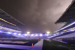 Lightning lights up clouds above Husky Stadium during a weather delay in the first quarter of an NCAA college football game between Washington and California, Saturday, Sept. 7, 2019, in Seattle. Fans were directed to seek shelter in nearby buildings due to severe weather in the area. (AP Photo/Ted S. Warren)