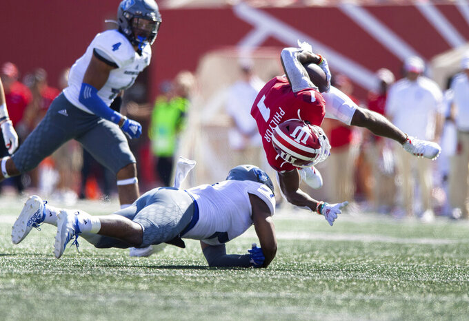 Indiana wide receiver Whop Philyor (1) flies into the air after being hit by Eastern Illinois safety Bryce Dewberry (2) during the first half of an NCAA college football game Saturday, Sept. 7, 2019, in Bloomington, Ind. (AP Photo/Doug McSchooler)
