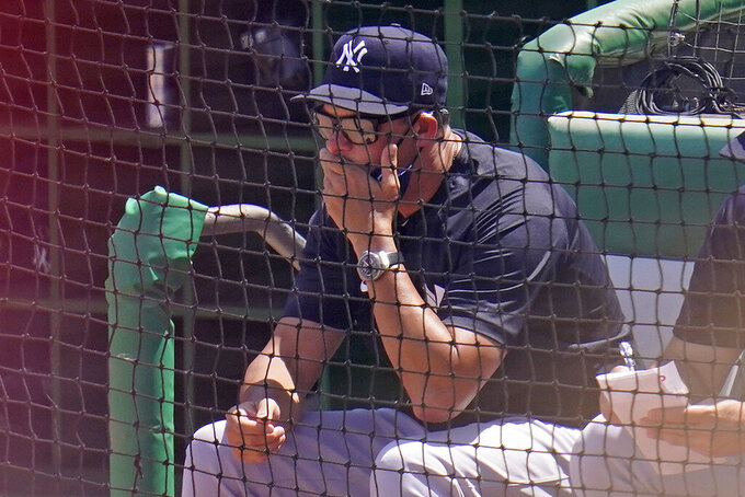New York Yankees manager Aaron Boone watches a spring training exhibition baseball game against the Philadelphia Phillies in Clearwater, Fla., Sunday, March 28, 2021. (AP Photo/Gene J. Puskar)