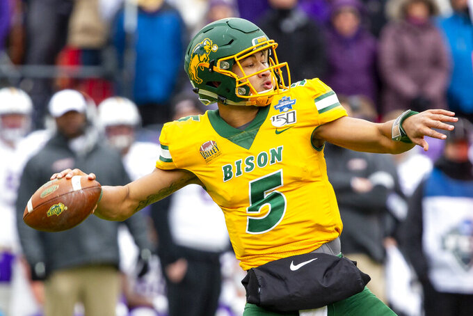 FILE - North Dakota State quarterback Trey Lance (5) winds up to throw during the first half of the FCS championship NCAA college football game against James Madison in Frisco, Texas, in this Saturday, Jan. 11, 2020, file photo. Lance is a likely first round pick in the NFL Draft, April 29-May 1, 2021, in Cleveland.(AP Photo/Sam Hodde, File)