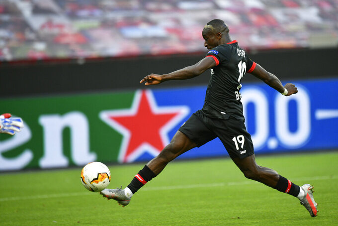 Leverkusen's Moussa Diaby scores the opening goal during the Europa League round of 16, second leg, soccer match between Bayer Leverkusen and Glasgow Rangers at the BayArena in Leverkusen, Germany, Thursday, Aug. 6, 2020. (Sascha Schuermann, Pool Photo via AP)
