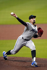 Miami Marlins starting pitcher Pablo Lopez (49) delivers in the first Inning of a baseball game against the Atlanta Braves Thursday, Sept. 24, 2020, in Atlanta. (AP Photo/John Bazemore)