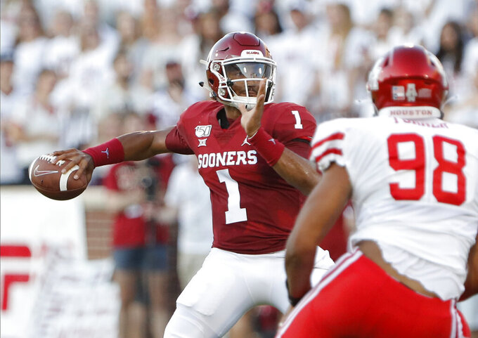 Oklahoma quarterback Jalen Hurts (1) passes the ball against Houston during the first half of an NCAA college football game in Norman, Okla., Sunday, Sept. 1, 2019. (AP Photo/Alonzo Adams)
