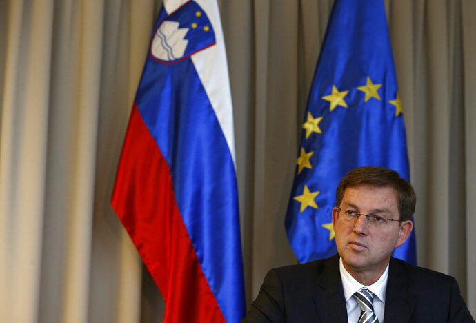 FILE - In this Monday, Nov. 28, 2016 file photo, former Slovenian prime minister and present foreign minister Miro Cerar speaks during an interview with the Associated Press, in Ljubljana, Slovenia. Cerar said in an interview with The Associated Press on Tuesday that there are some positive effects on the part of the European Union regarding Brexit because we in a way upheld our unity during this process, we showed that we are able to stand behind a small state, Ireland, to protect its interests. (AP Photo/Darko Vojinovic, File)