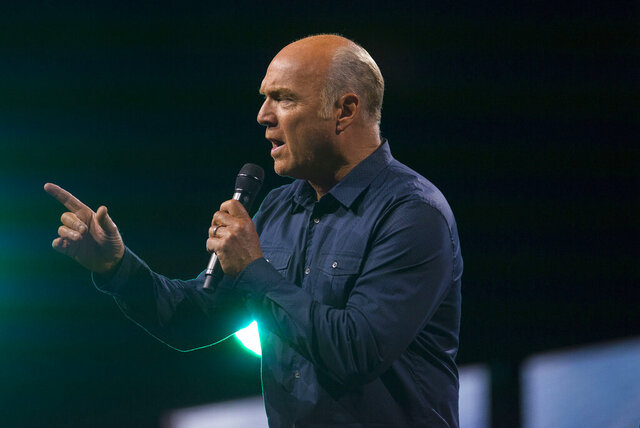 FILE - In this Aug. 18, 2017, file photo, Greg Laurie delivers his sermon during the opening night of Harvest Crusade at Angel Stadium in Anaheim, Calif. Laurie, of Harvest Christian Fellowship in Riverside, said Monday, Oct. 5, 2020, that he tested positive for the coronavirus and is in quarantine. Laurie says his symptoms are mild and he expects to make a full recovery. (Matt Masin/The Orange County Register via AP, File)