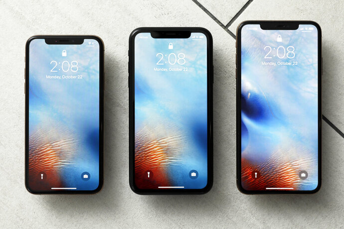 FILE - This Oct. 22, 2018, file photo shows the iPhone XS, from left, iPhone XR, and the iPhone XS Max in New York. Apple on Tuesday, Sept. 17, 2019, deepened its ties with a Kentucky manufacturing plant by awarding $250 million to support Corning Inc.'s continued work to develop glass for iPhones and other devices. The award builds on the $200 million that Corning received from Apple's Advanced Manufacturing Fund in 2017, the tech giant said.  (AP Photo/Richard Drew, File)