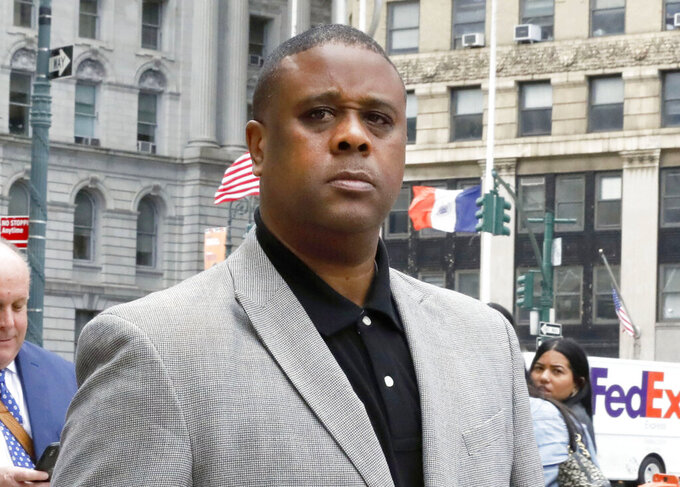 "FILE - Former amateur basketball league director Merl Code, leaves federal court in New York on Oct. 4, 2019 after sentencing for his role in a college basketball bribery scheme that focused on NBA-bound athletes. Hanover Square Press announced Tuesday that Code's ""Black Market"" will be published in March 2022. Hanover is calling the book an ""explosive insider account of the dark underworld of college basketball."" (AP Photo/Richard Drew, File)"