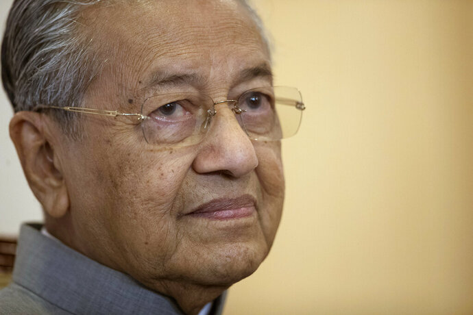 Malaysian Prime Minister Mahathir Mohamad listens to questions during an interview with foreign media in Putrajaya, Malaysia, Thursday, May 9, 2019. Mahathir reiterates that he is an interim prime minister and will stick to his promise to hand over to his successor Anwar Ibrahim. Mahathir told foreign journalists at a briefing to mark his government's first anniversary in power that they will next focus on bolstering the economy after moves to combat corruption and fix the country's finances in the past year. (AP Photo/Vincent Thian)