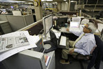 In this Wednesday, Aug. 7, 2019, photo, Bertram de Souza works on a story for The Vindicator newspaper in Youngstown, Ohio. The Youngstown paper announced in June it would cease publication Saturday, Aug. 31, because of financial struggles, but the paper will be printed by the Tribune Chronicle, which has bought The Vindicator name, subscriber list and website from owners of the Youngstown publication. (AP Photo/Tony Dejak)
