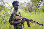 In this photo taken Wednesday, Aug. 28, 2019, an opposition soldier stands guard at an opposition military camp near the town of Nimule in Eastern Equatoria state, South Sudan. South Sudan's fragile peace deal is faltering Wednesday Oct. 16, 2019, less than one month before the country's president and armed opposition leader are meant to form a unity government and begin the long recovery from a five-year civil war. (AP Photo/Sam Mednick)