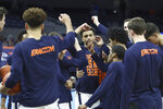 Virginia players gather before an NCAA college basketball game against Pittsburgh, Saturday, Feb. 6, 2021, in Charlottesville, Va. (Erin Edgerton/The Daily Progress via AP, Pool)