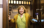 Belarusian Svetlana Alexievich, the 2015 Nobel literature laureate smiles as she opens her apartment door to greet supporters in Minsk, Belarus, Wednesday Sept. 9, 2020. On Wednesday morning unidentified people tried to enter the apartment of the last member of the council's executive presidium who remained free. (AP Photo/TUT.by)