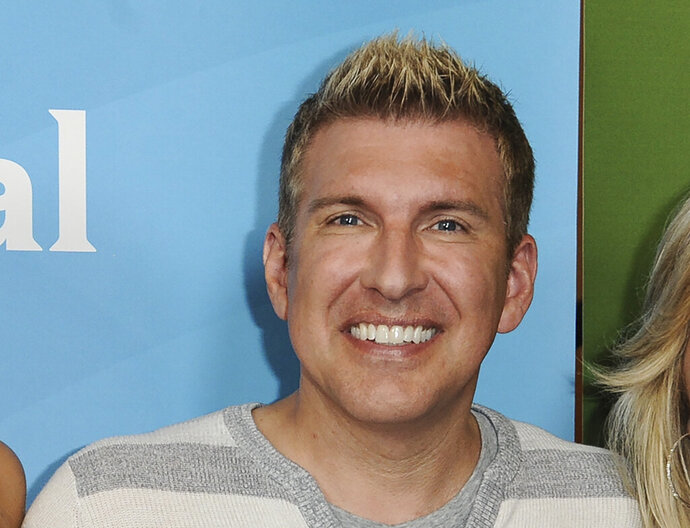 FILE - In this July 14, 2014, file photo, Todd Chrisley attends the NBC 2014 Summer TCA at the Beverly Hilton Hotel in Beverly Hills, Calif. A federal grand jury in Atlanta on Tuesday, Aug. 13, 2019, indicted reality television star Chrisley on tax evasion and other charges. (Photo by Richard Shotwell/Invision/AP, File)