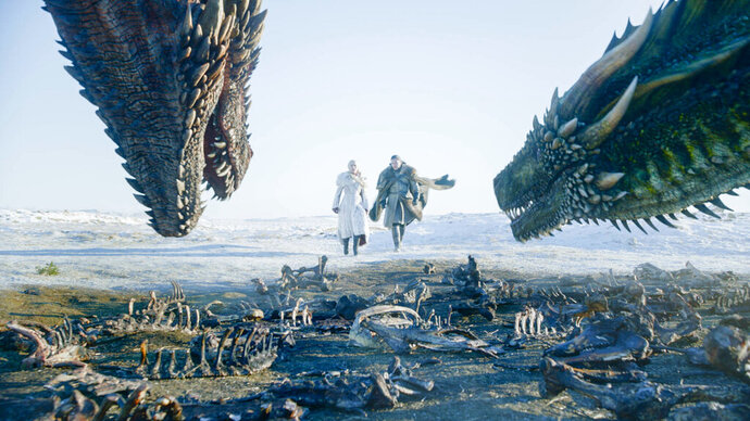 This image released by HBO shows Emilia Clarke, left, and Kit Harington in a scene from the final episode of