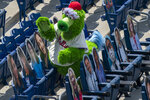 The Phillie Phanatic tries to interact with the cardboard cutouts of the fans in the stands during the third inning of a baseball game against the Miami Marlins, Sunday, July 26, 2020, in Philadelphia. (AP Photo/Chris Szagola)