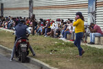 People wearing protective face masks amid the new coronavirus pandemic wait their turn to enter a state-run store in Havana, Cuba, Thursday, Jan. 14, 2021. The government is implementing a deep financial reform that reduces subsidies, eliminates a dual currency that was key to the old system, and raises salaries, in hopes of boosting productivity to help alleviate an economic crisis and reconfigure a socialist system that will still grant universal benefits such as free health care and education. (AP Photo/Ramon Espinosa)