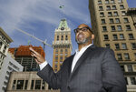 In this July 2, 2019, photo, Martin Reynolds, co-executive director of the Maynard Institute, speaks during an interview outside the Tribune Tower, the former home of the Oakland Tribune newspaper in Oakland, Calif.