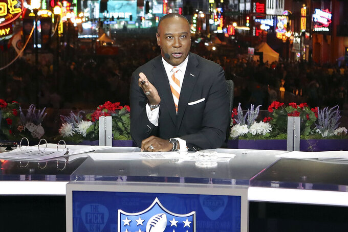 FILE - In this April 25, 2019, file photo, Charles Davis speaks on the NFL Network set in Nashville, Tenn. Despite last-minute schedule changes, pregame features being done remotely and announcers being separated by more than six feet and plexiglass, networks have been able to weather the challenges of airing games during a pandemic. (AP Photo/Gregory Payan, File)