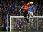 Manchester United's Scott McTominay, left, jumps for the ball with Manchester City's Gabriel Jesus during the English Premier League soccer match between Manchester City and Manchester United at Etihad stadium in Manchester, England, Saturday, Dec. 7, 2019. (AP Photo/Rui Vieira)