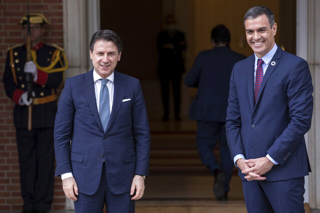 Spanish Prime Minister Pedro Sanchez, right, and Italy's Prime Minister Giuseppe Conte pose for the media at the Moncloa palace in Madrid, Spain, Wednesday, July 8, 2020. (AP Photo/Bernat Armangue)