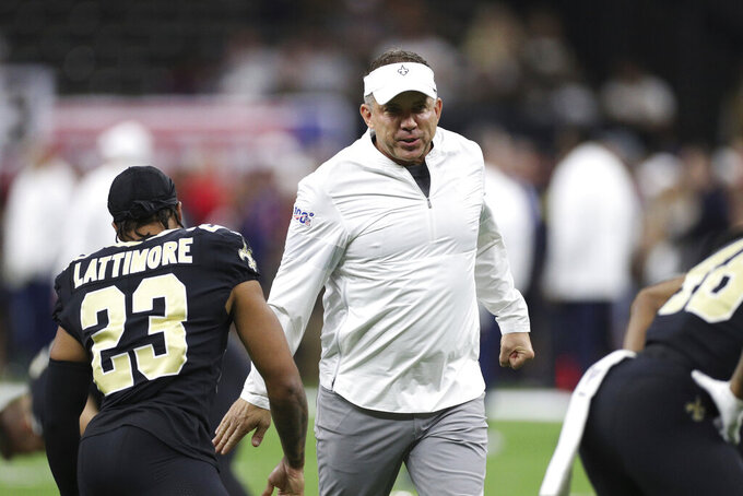 New Orleans Saints head coach Sean Payton greets the players during warm-ups during an NFL game against the Houston Texans, Monday, Sept. 9, 2019, in New Orleans. The Saints defeated the Texans 30-28. (Margaret Bowles via AP)