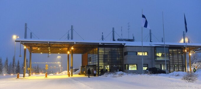 FILE - This Jan. 23, 2016, file photo, shows the Finnish-Russian border crossing point in Salla, northern Finland. Salla has launched a firmly tongue-in-cheek bid for the 2032 Summer Olympics, hoping to use its campaign to raise awareness about climate change and global warming. (Jussi Nukari/ Lehtikuva via AP, File )
