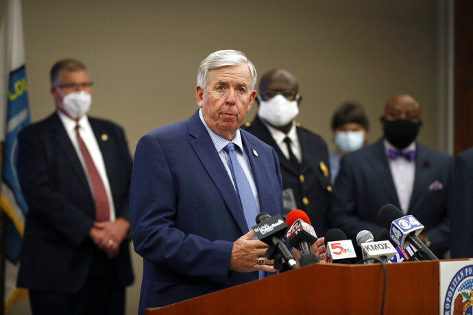 Missouri Gov. Mike Parson speaks during a news conference Thursday, Aug. 6, 2020, in St. Louis. Officials announced St. Louis has been added to the list of cities that will receive assistance from Operation Legend, a federal anti-crime program launched to help city police in their effort to reduce violent crime. (AP Photo/Jeff Roberson)