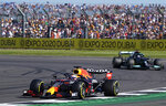 Red Bull driver Max Verstappen of the Netherlands steers his car followed by Mercedes driver Lewis Hamilton of Britain during the Sprint Qualifying of the British Formula One Grand Prix, at the Silverstone circuit, in Silverstone, England, Saturday, July 17, 2021. The British Formula One Grand Prix will be held on Sunday. (AP Photo/Jon Super)