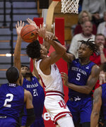 Indiana's Jerome Hunter (21) is fouled by North Alabama's Mervin James (5) as he tries to get a shot off during the second half of an NCAA college basketball game, Tuesday, Nov. 12, 2019, in Bloomington, Ind. Indiana won 91-65. (AP Photo/Doug McSchooler)