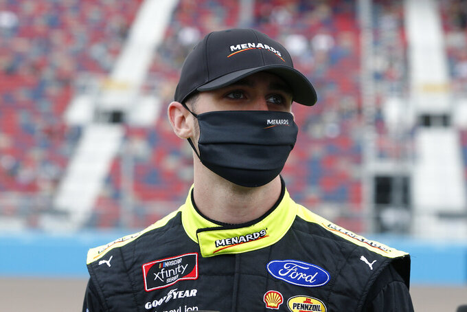 Austin Cindric looks on from pit road prior to the NASCAR Xfinity Series auto race at Phoenix Raceway, Saturday, Nov. 7, 2020, in Avondale, Ariz. (AP Photo/Ralph Freso)